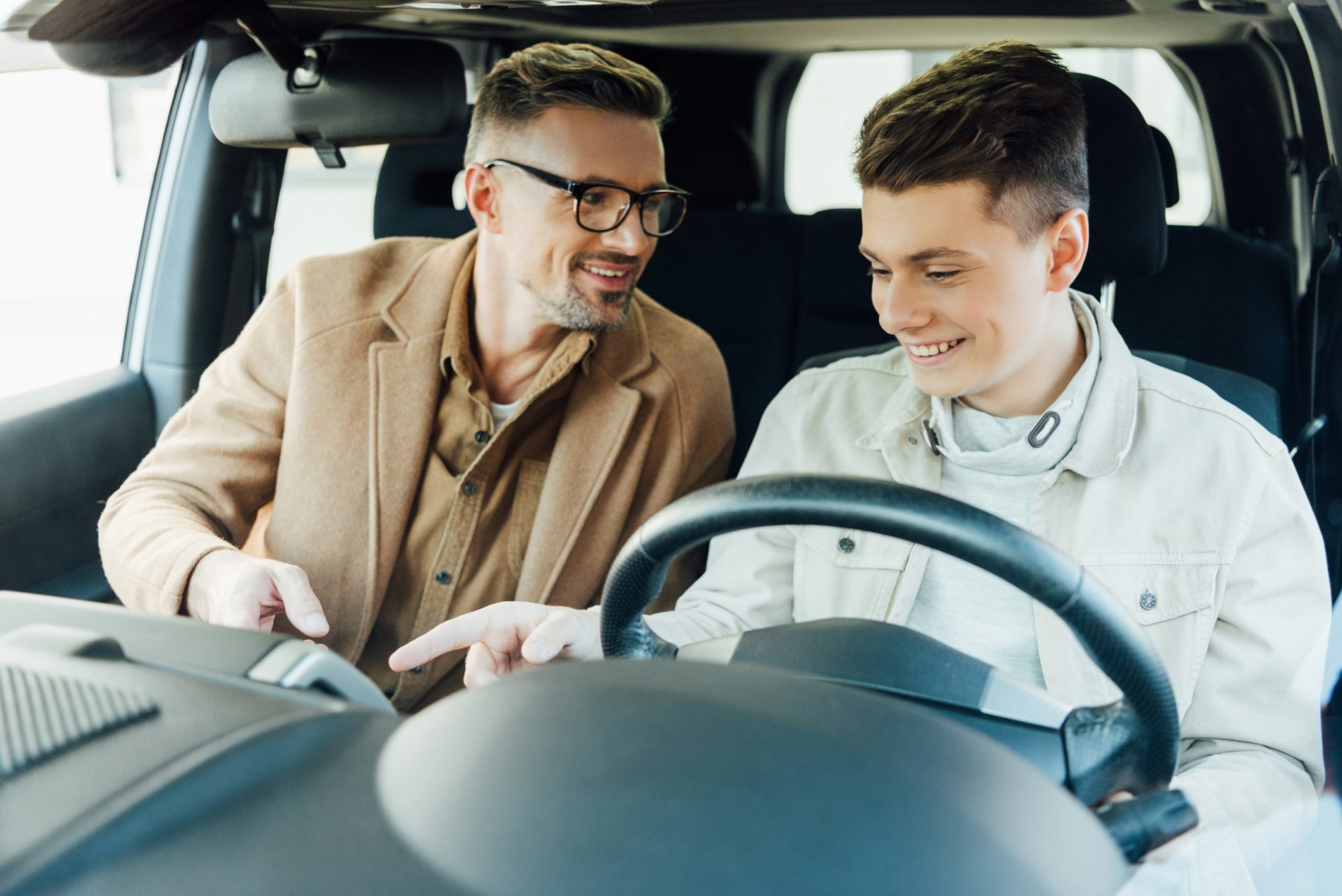 dad-teaching-son-how-to-drive