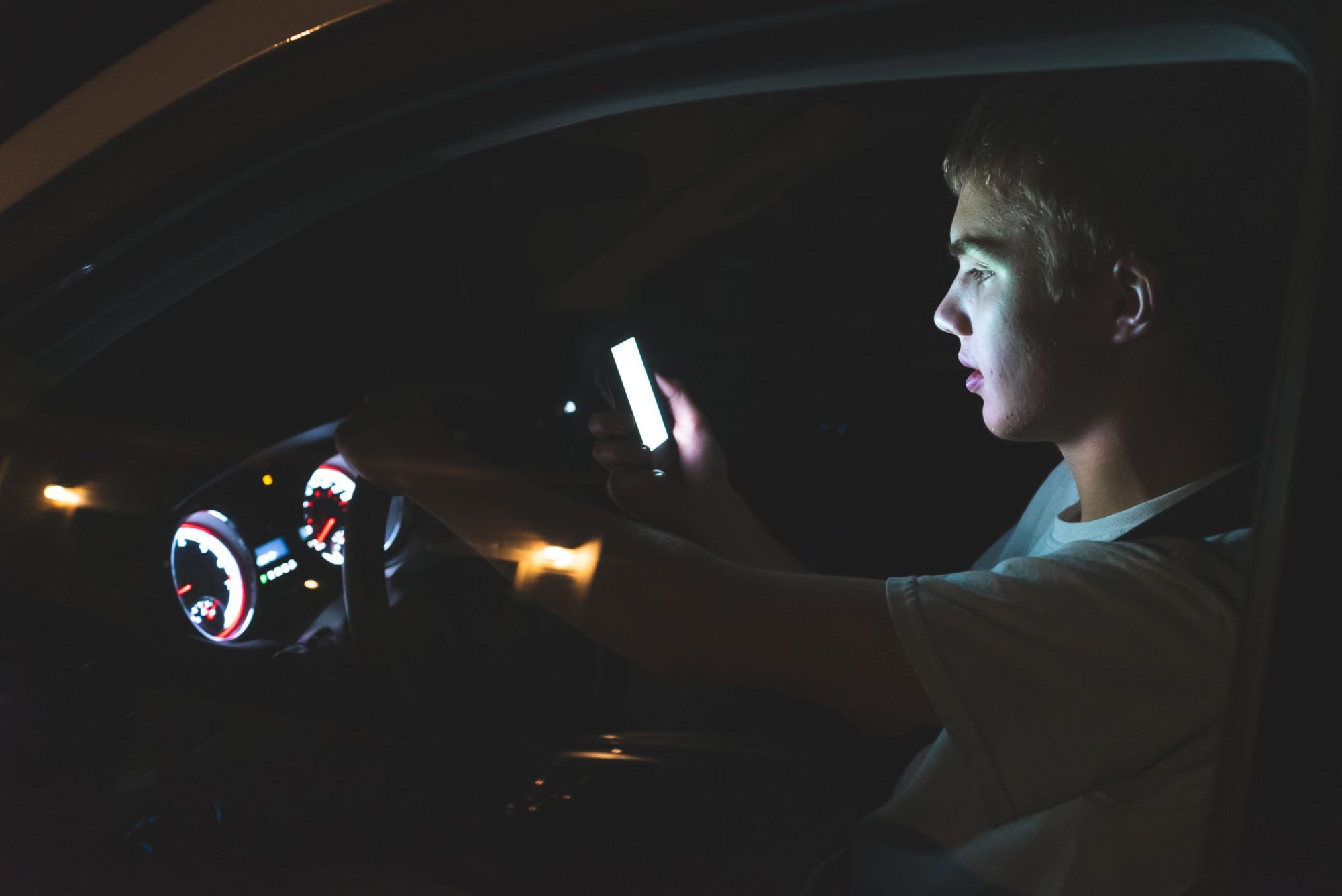 distracted-teenage-driver-on-cell-phone