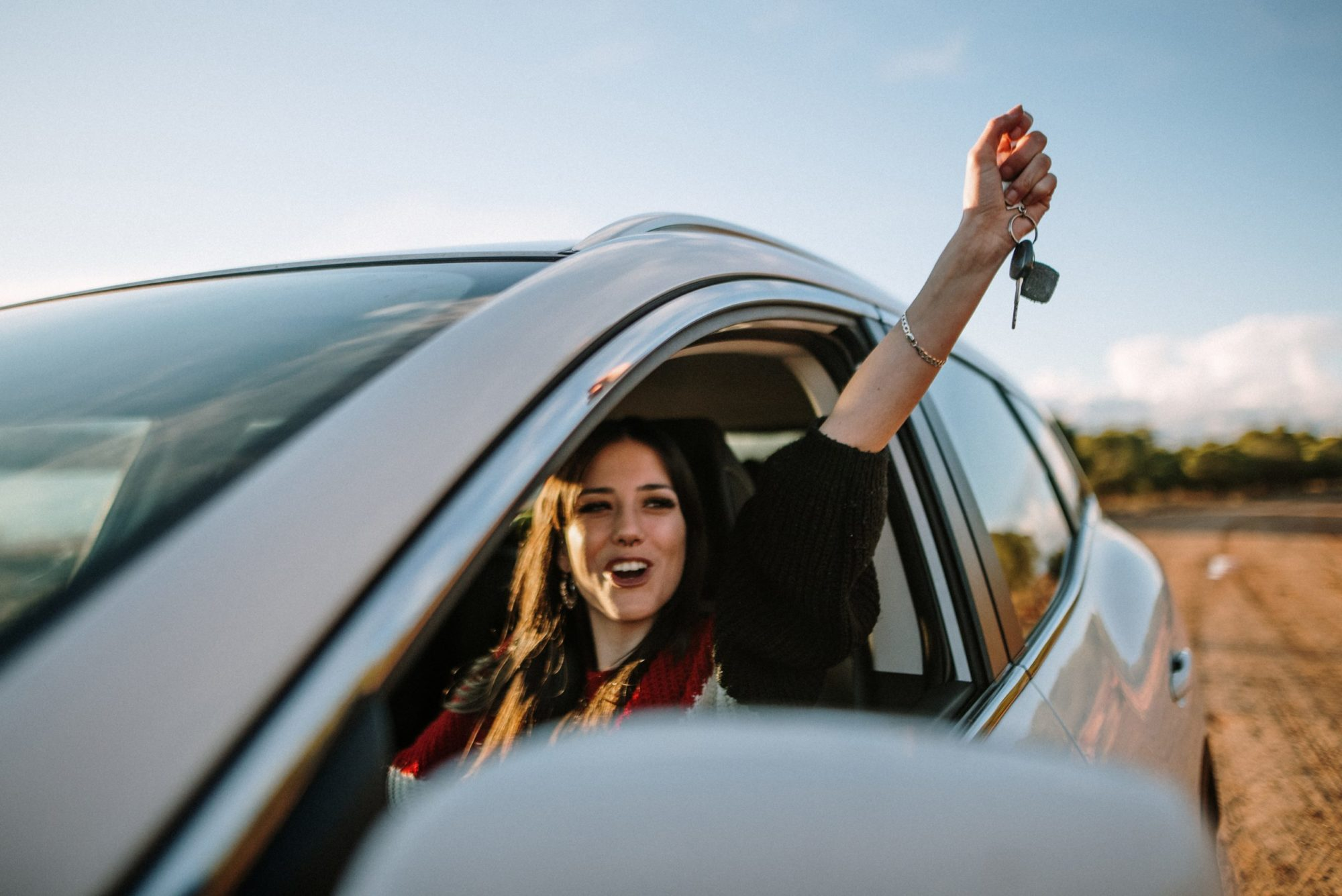 young-woman-proudly-holds-up-car-keys