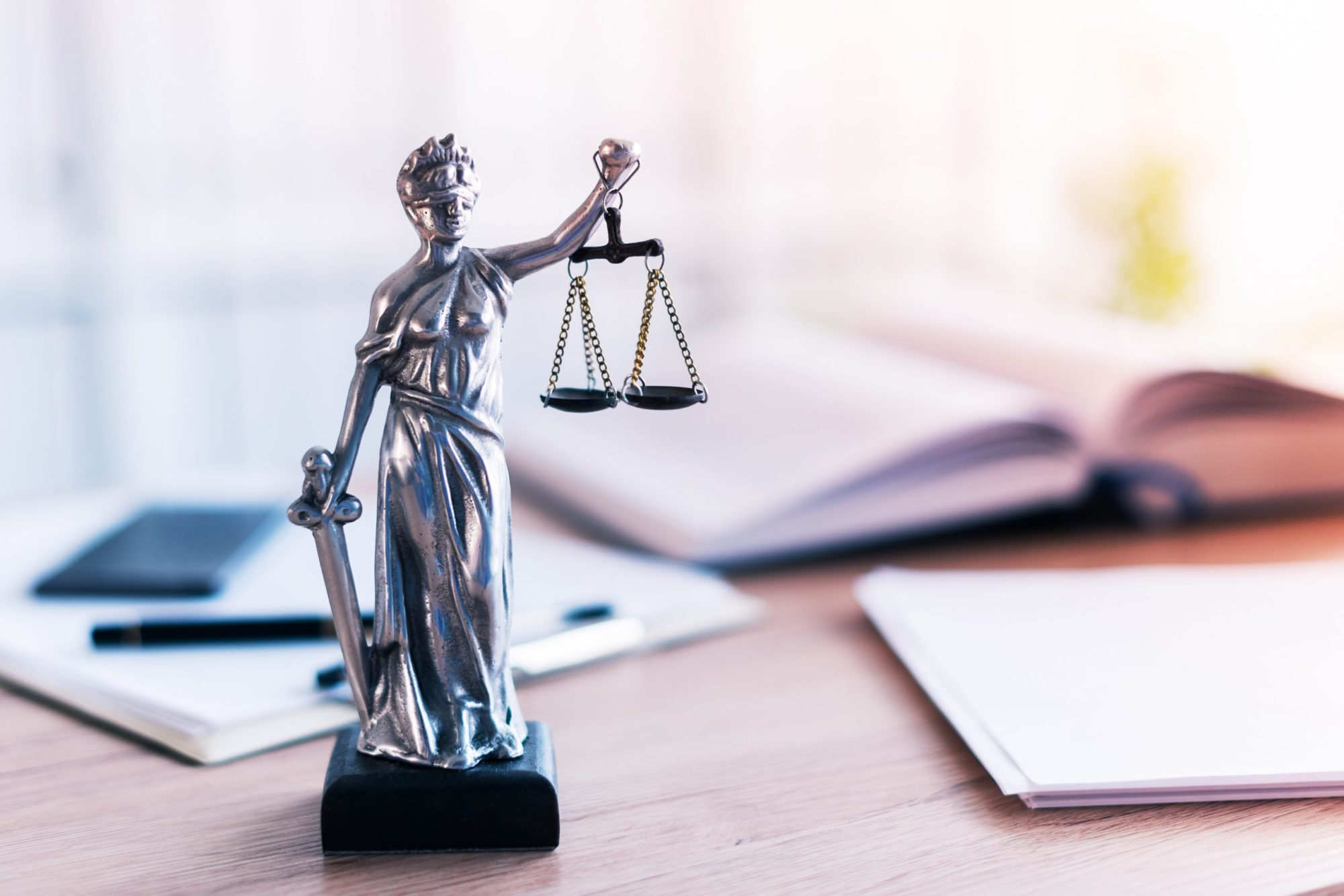 Lady Justice sitting on a personal injury lawyers desk