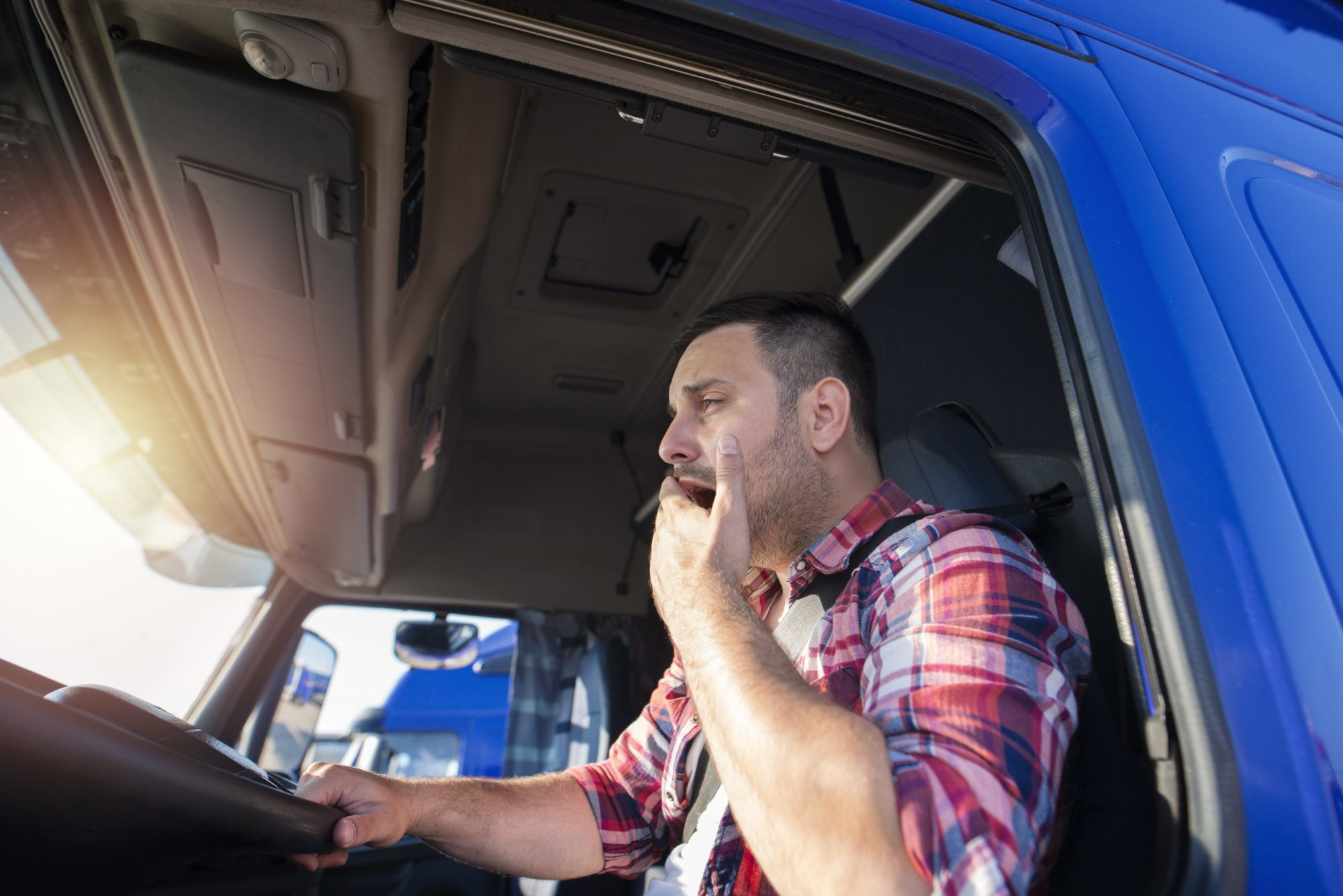 truck driver showing signs of drowsy driving