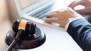 Lawyer Typing On Laptop Computer Stock Photo