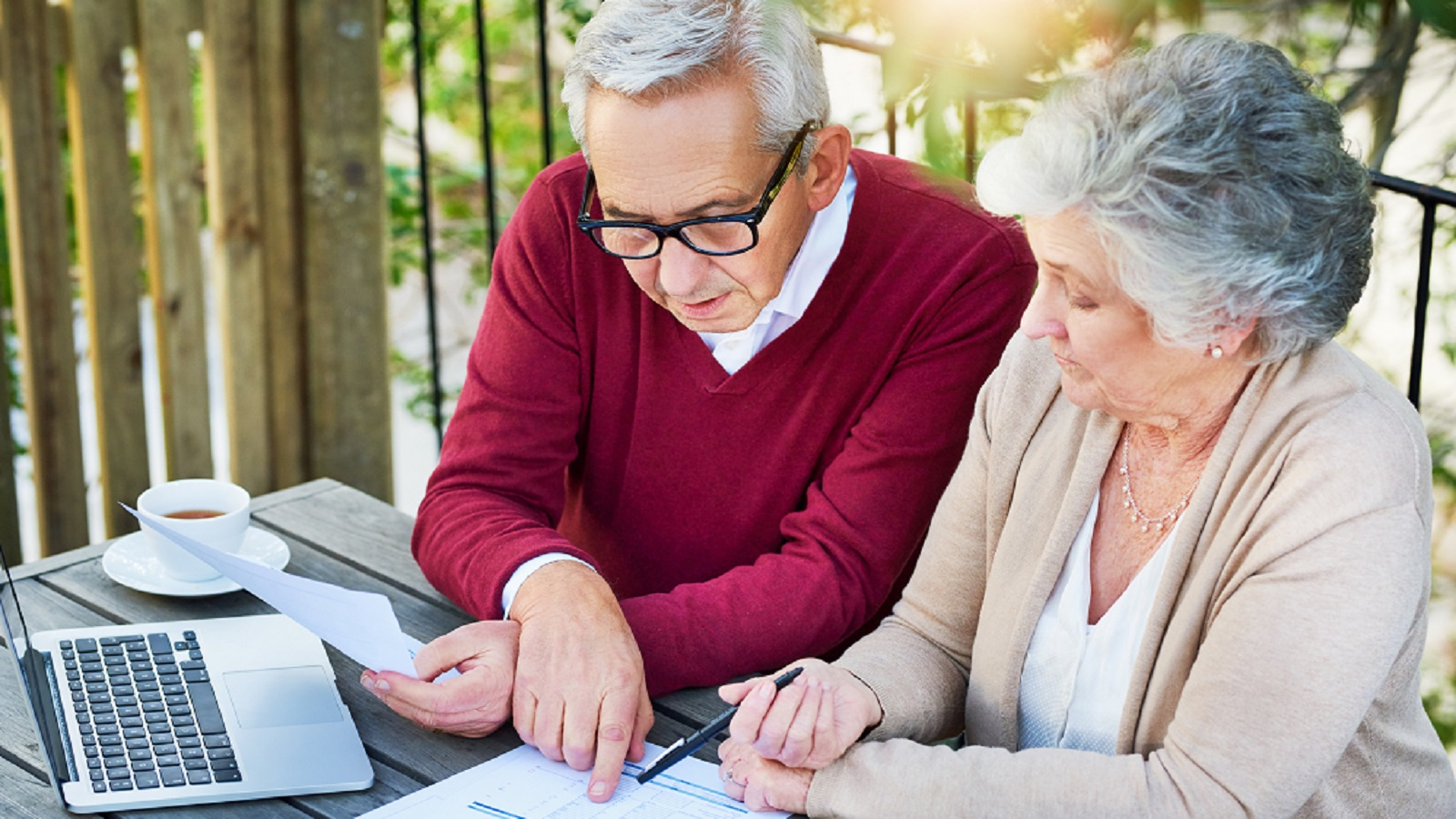 Elderly Couple Reviewing Their Finances Together Stock Photo