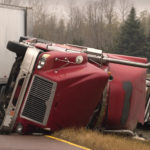 The scene of a big truck accident on the road.